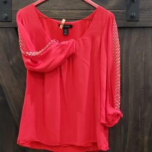 Orange silk blouse with goldtone accents
